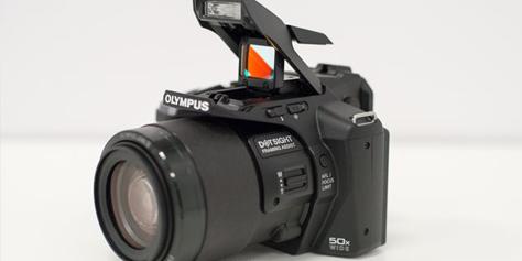 Imagem de A Olympus SP-100 é uma câmera com superzoom e mira red dot no site TecMundo
